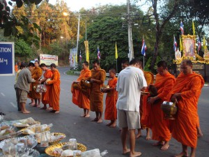 give alms to a Buddhist monk in morning (website)