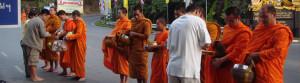 offer food for the monk (slide)